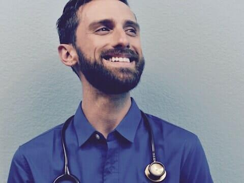 A happy, professional nurse health coach.